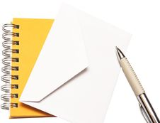 Free White Envelope Spiral Notepad And Pen Royalty Free Stock Images - 15871129