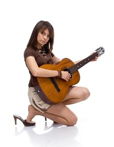 Free Girl Playing Acoustic Guitar Stock Photography - 15873492