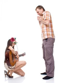 Free Girl Plays The Guitar For A Boy Royalty Free Stock Photo - 15873495