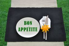 Free Bon Appetite Text On Plate Silverware Grass Stock Photography - 15873982