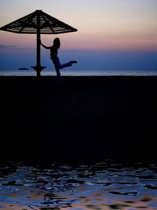 Free Umbrella And The Girl On A Beach. Evening Royalty Free Stock Photo - 15874365