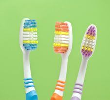 Free Colourful Toothbrushes Royalty Free Stock Photography - 15874427