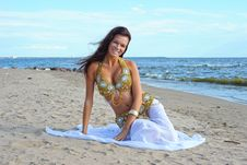 Beautiful Sitting Woman In Exotic Dress Stock Images