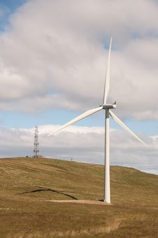 Wind Turbine And Communications Transmitter Royalty Free Stock Photos
