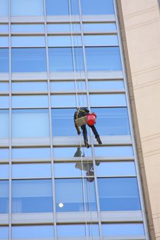 Window Washer And A Glass Wall Stock Images