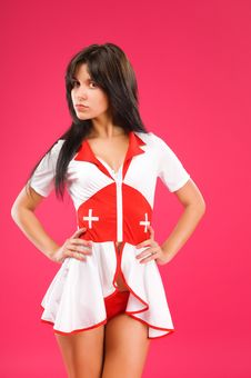Free Sensual Brunette Nurse Posing On Royalty Free Stock Photography - 15877867