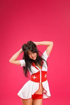 Sensual Brunette Nurse Posing Royalty Free Stock Image