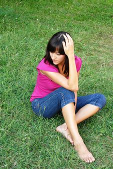 Free Young Woman Sitting On Grass Stock Photos - 15878783