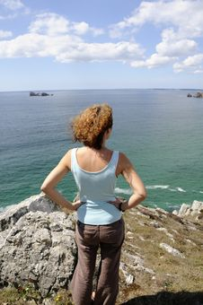 Young Woman Watching The Ocean Stock Photography