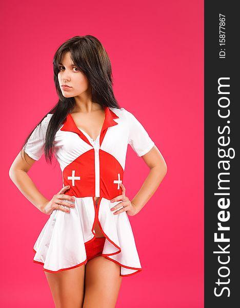 Sensual brunette nurse posing on