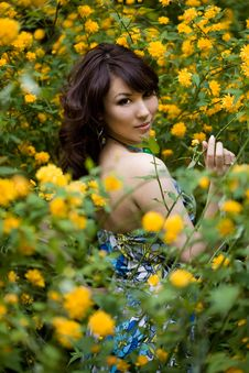 Free Girl In The Garden With Flowers Stock Image - 15887071