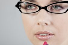 Woman Applying Lipstick Stock Photo