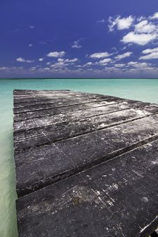 Free Dock Leading Into Carbibean Water Stock Photography - 15888522