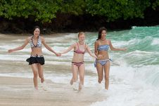 Free Three Girls Run On The Beach Stock Photography - 15889772