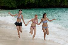 Free Three Girls Run On The Beach Stock Photography - 15889782