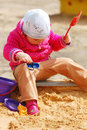 Free The Little Girl In A Sandbox Stock Images - 15891434