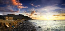 Free Sunset Over Rocky Coast Stock Photography - 15890592