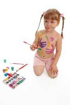 Little Girl With Paints Stock Photo