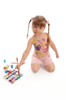 Little Girl With Paints And A Brush Stock Images
