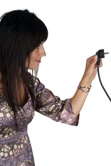 Free Woman Plugging Electric Cord. Side View. Stock Image - 15891941