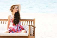 Beautiful Girl Sitting On Beach Sofa Stock Image