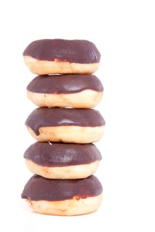 Free Five Stacked Chocolate Donuts Royalty Free Stock Image - 15893396