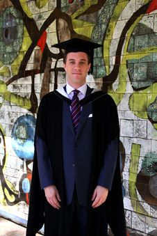 Free A Young Man In A Graduation Gown. Royalty Free Stock Image - 15894326
