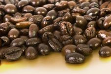 Free Coffee Beans On Gold Royalty Free Stock Photo - 1592625