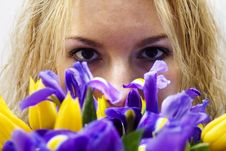 Free Blondgirl Smelling Flowers Royalty Free Stock Images - 1593449