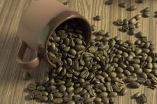 Cup Filled With Coffee Beans Royalty Free Stock Photo