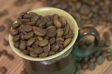 Cup Filled With Coffee Beans Royalty Free Stock Photography