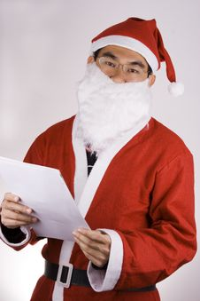 Free Santa Claus With Check List Royalty Free Stock Photography - 1596257
