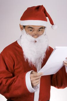 Free Santa Claus With Check List Royalty Free Stock Photo - 1596275