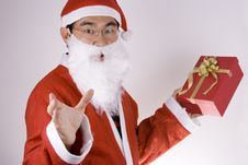 Santa Claus Holding A Present Royalty Free Stock Images
