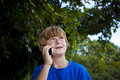 Free Young Boy Talking On A Cell Phone. Stock Photos - 15908013