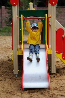 Free Small Girl In Yellow Rain Coat In Playground Stock Photo - 15902710