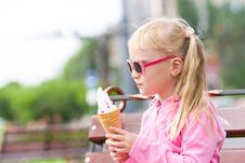 Free Little Blond Girl Eating Ice-cream Stock Images - 15903494