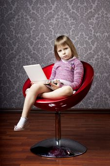 Girl Sitting In A Chair With A Laptop Stock Image
