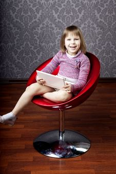 Girl Sitting In A Chair With A Laptop Stock Images