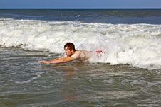 Free Young Boy Is Body Surfing In The Waves Royalty Free Stock Photography - 15905987