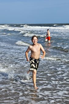 Free Boy Running Along The Beautiful Beach In The Waves Stock Photo - 15906510