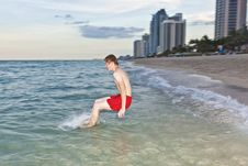Boy Jumps With Speed Into The Ocean Stock Image