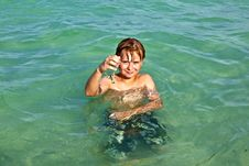 Boy Enjoys The Clear Water In The Ocean Royalty Free Stock Image