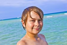 Free Boy Enjoys The Clear Water In The Ocean Royalty Free Stock Photo - 15907275