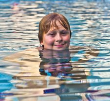 Boy Enjoys Swimming In The Pool Royalty Free Stock Photography