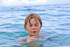 Child Is Swimming In The Ocean Stock Image