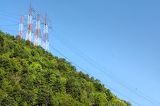 Free High Voltage Line Above Green Forest Royalty Free Stock Photography - 15908907