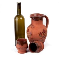 Wine Bottle, Clay Pot And Cup Stock Photography