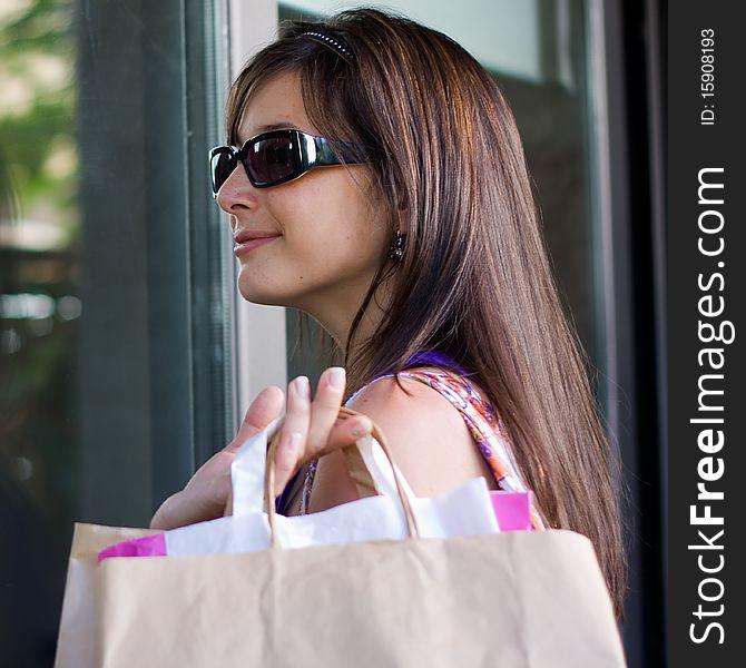 Beautiful woman at a shopping center