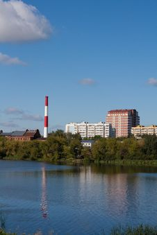 Buildings And Boiler-house On Riverside Stock Photography